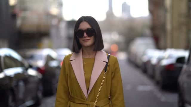 a guest wears leo print sunglasses a yellow outfit a bimba y lola bag during london fashion week february 2018 on february 16 2018 in london england - london fashion week stock videos and b-roll footage