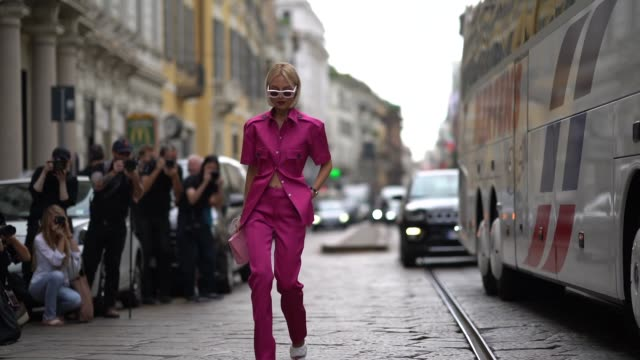 guest wears pink sunglasses, a pink shirt, pink pants, white sandals, a bag, outside the peter pilotto show during milan fashion week spring/summer... - hairstyle stock videos & royalty-free footage