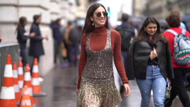a guest wears ray ban sunglasses a rustcolor long sleeves turtleneck a glittering sequined gold tone pleated jumper burgundy suede wedgeheels... - knee highs stock videos and b-roll footage