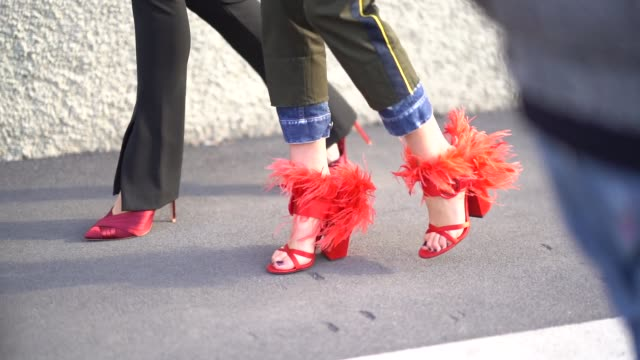 A guest wears red heels shoes with fur during Milan Menswear Fashion week Fall/Winter 2018/19 on January 14 2018 in Milan Italy