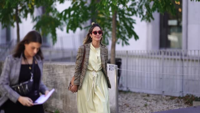 guest wears red sunglasses, a tartan checked blazer jacket, a yellow dress, a brown leather loewe bag, red sandals shoes, during paris fashion week... - sandal stock videos & royalty-free footage