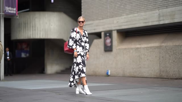 a guest wears sunglasses a black and white floral print dress white shoes a red bag during london fashion week september 2018 on september 16 2018 in... - floral pattern stock videos & royalty-free footage