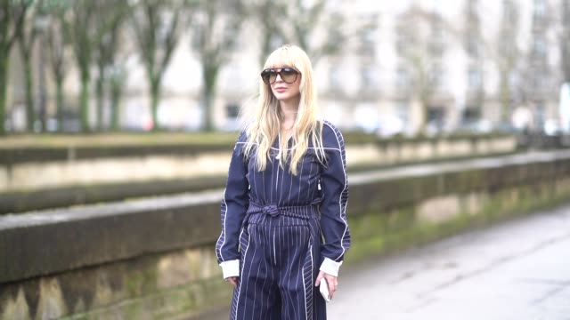 A guest wears sunglasses a blue and white striped outfit outside Valentino during Paris Fashion Week Womenswear Fall/Winter 2018/2019 on March 4 2018...