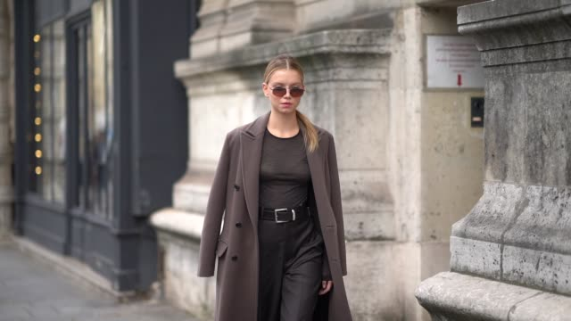 a guest wears sunglasses a brown top a black belt dark brown fulllength pants a light brown coat black platform shoes outside beautiful people during... - full length stock videos & royalty-free footage