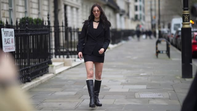 a guest wears sunglasses a choker a black blazer jacket a leather bag a skirt black leather high boots during london fashion week fall winter 2020 on... - halsreif stock-videos und b-roll-filmmaterial