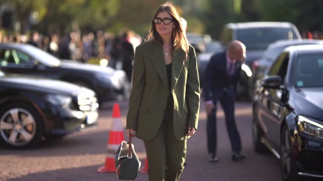A guest wears sunglasses a green blazer jacket outside Hermes during Paris Fashion Week Womenswear Spring/Summer 2019 on September 29 2018 in Paris...