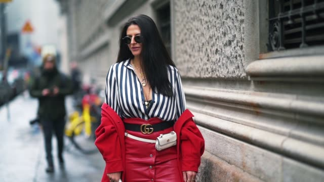 a guest wears sunglasses a striped shirt a gucci belt a red skirt gucci shoes during milan fashion week fall/winter 2018/19 on february 24 2018 in... - skirt stock videos & royalty-free footage