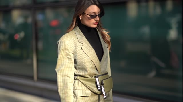 A guest wears sunglasses a turtleneck a checked blazer jacket during Milan Menswear Fashion week Fall/Winter 2018/19 on January 13 2018 in Milan Italy
