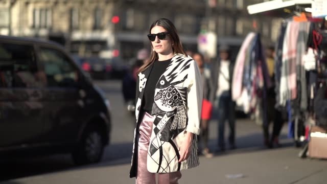 a guest wears sunglasses earrings a large jacket with black and white inserts lustrous pink pants black highheeled sandals outside rochas during... - sandal stock videos & royalty-free footage