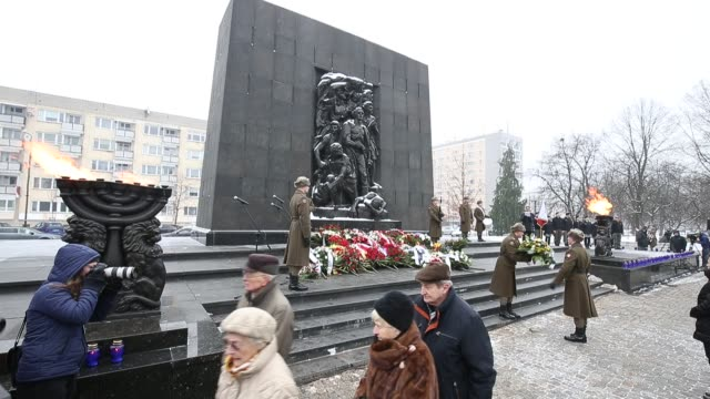 guests are seen at the holocaust commemoration service at the ghetto heroes monument in warsaw, poland on january 27, 2019. this year marks the 75ht... - international holocaust remembrance day stock videos & royalty-free footage