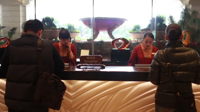 guests are served at a check in counter in the lobby of the galaxy macau casino resort, operated by galaxy entertainment group ltd, in macau, china,... - macao stock videos & royalty-free footage