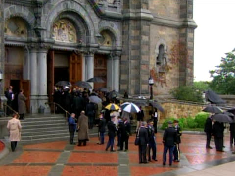 guests arrive at our lady of perpetual help basilica church for senator ted kennedy's funeral service 29 august 2009 - perpetual motion stock videos & royalty-free footage