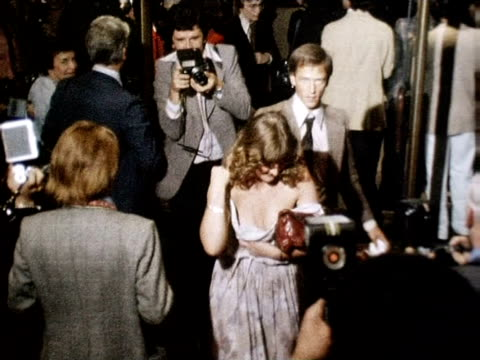 guests arrive in stampede at premiere of film 'grease' 13 september 1978 - film premiere stock videos & royalty-free footage