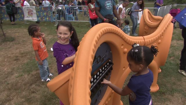 atmosphere guests at nickelodeon's 10 annual worldwide day of play celebration more than 50000 kids and families join brook lopez ariana grande big... - nickelodeon stock videos & royalty-free footage