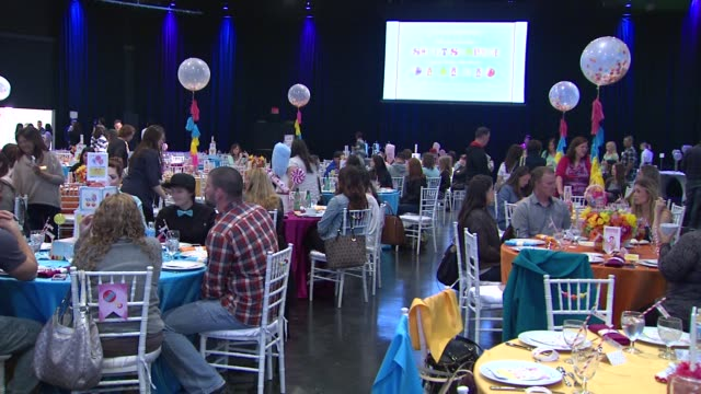 atmosphere guests at the babies r us throws a #trulyscrumptious operation shower event hosted by heidi klum at the globe theatre at universal studios... - heidi klum stock videos and b-roll footage