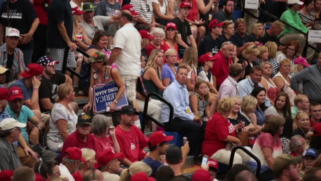 guests attend a rally where president donald trump was speaking to show support for ohio republican congressional candidate troy balderson on august... - political rally stock videos & royalty-free footage