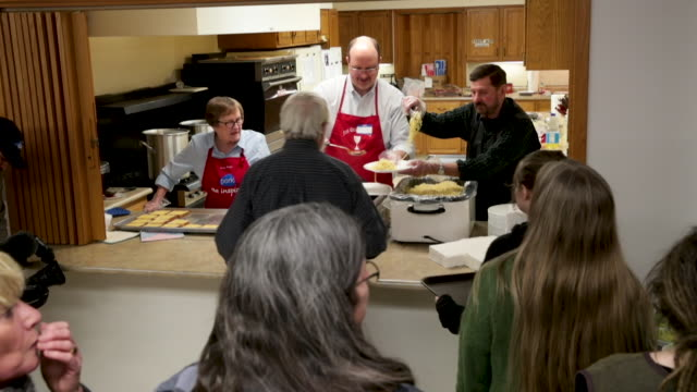 guests attend the monroe county democrats spaghetti supper at the first christian church on february 17 2019 in albia iowa us senator amy klobuchar... - john scott stock videos and b-roll footage