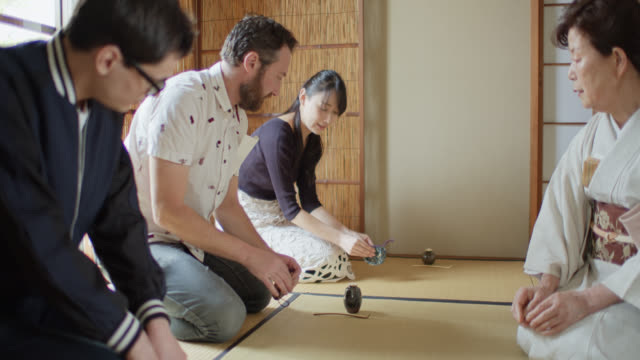 guests being instructed at japanese traditional tea ceremony - kimono stock videos & royalty-free footage