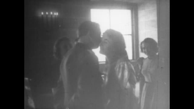 stockvideo's en b-roll-footage met guests celebrate at nazi wedding reception / note from eva braun's home movie collection - heinrich himmler