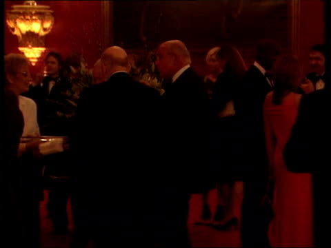 guests chatting at party sting chatting prince charles chatting to guests tx 13.3.2001/c5l - プリンスズトラスト点の映像素材/bロール