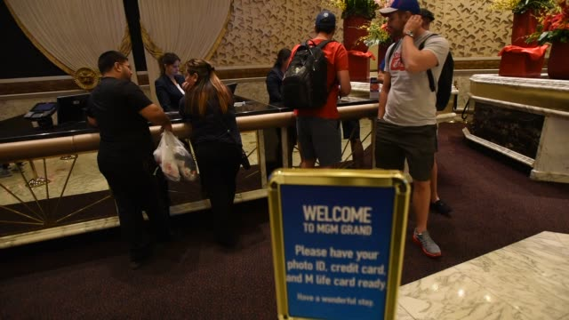 Guests check in at the MGM Resorts International Grand Hotel Casino in Las Vegas Nevada US on Tuesday Feb 16 2016 MGM Resorts International is...