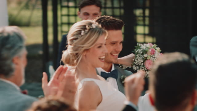 guests cheering for bridegroom picking up bride - guest stock videos & royalty-free footage