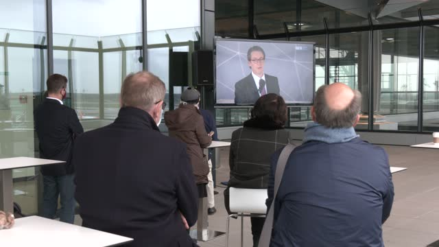 guests follow the live transmission of the speech of minister of transport andreas scheuer at the observation deck after the landing of the first two... - berlin tegel international airport stock videos & royalty-free footage
