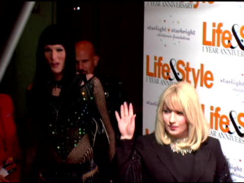 vídeos de stock, filmes e b-roll de guests in cher and barbra streisand costumes at the life and style weekly celebratation of its one-year anniversary with a celebrity masquerade at... - barbra streisand
