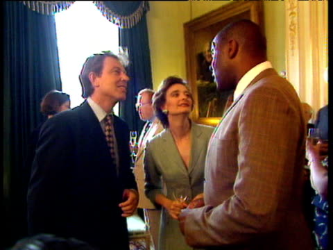 stockvideo's en b-roll-footage met guests including neil tennant frank bruno ross kemp kevin spacey alastair campbell and eddie izzard chat to each other and to tony and cherie blair... - tony blair