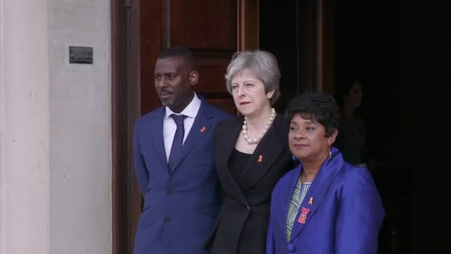 vídeos de stock e filmes b-roll de guests including theresa may, jeremy corbyn, sadiq khan and comedian lenny henry arrive for the memorial service to commerorate the 25th anniversary... - lenny henry