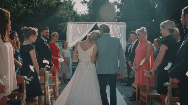 guests looking at bride and father walking on aisle - married stock videos & royalty-free footage