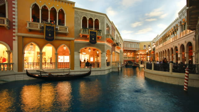 guests ride gondolas on the canals at the venetian casino and hotel on the las vegas strip. - venetian hotel las vegas stock videos & royalty-free footage