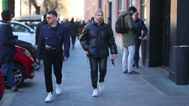 guests seen wearing denim jacket black pants black jacket white sneakers during milan menswear fashion week autumn/winter 2019/20 on january 14 2019... - denim jacket stock videos and b-roll footage