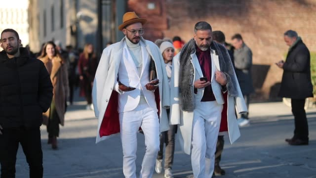 Guests seen wearing white coat pants blazer orange hat during the 95th Pitti Uomo at Fortezza Da Basso on January 10 2019 in Florence Italy