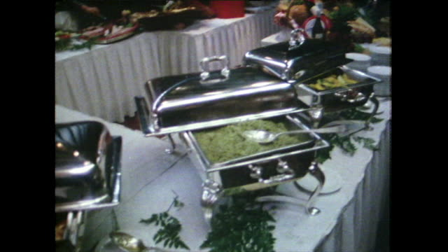 guests serve themselves from hotel buffet; 1981 - buffet stock videos & royalty-free footage