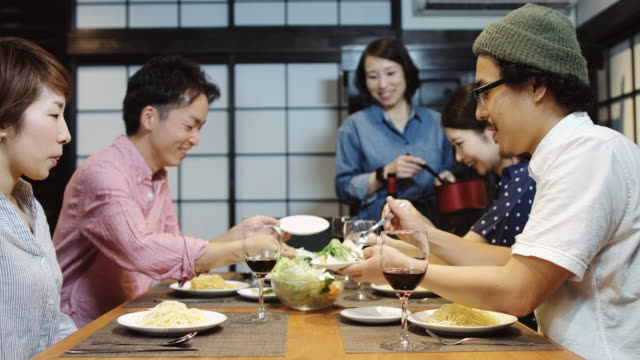 guests serving themselves at dinner party - only japanese stock videos & royalty-free footage