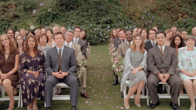 guests stand and applaud at a wedding. - blumenbouqet stock-videos und b-roll-filmmaterial