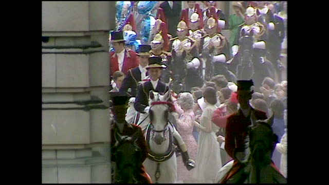 guests throw confetti at prince charles and princess diana as they depart buckingham palace to go to broadlands for their wedding night; 1981. - decoration stock videos & royalty-free footage