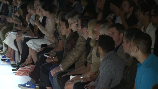 stockvideo's en b-roll-footage met guests watch models walk the runway at michael bastian s/s 2016 nyfw mens runway show at skylight clarkson sq on july 15 2015 in new york city - skylight clarkson sq