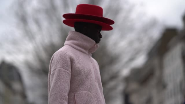 guests wear red hats during london fashion week february 2018 on february 18 2018 in london england - london fashion week stock videos and b-roll footage