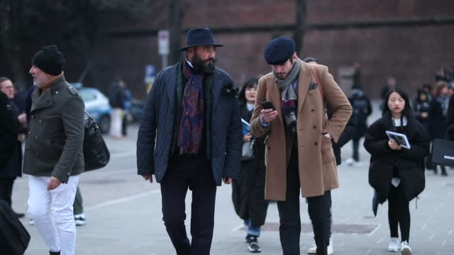 guests wearing hat flat cap navy jacket beige wool coat scarf during the 95th pitti uomo at fortezza da basso on january 8 2019 in florence italy - flat cap stock videos & royalty-free footage