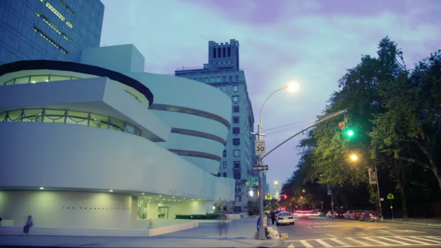 ws t/l guggenheim museum and traffic on road in downtown / new york, new york, usa - museum stock videos & royalty-free footage