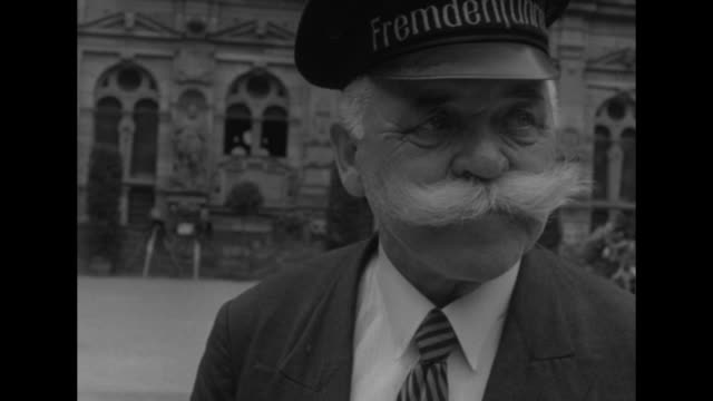 guide at heidelberg castle philip machling, man with large moustache / machling handing something to margaret truman, pres. harry truman's daughter,... - moustache stock videos & royalty-free footage