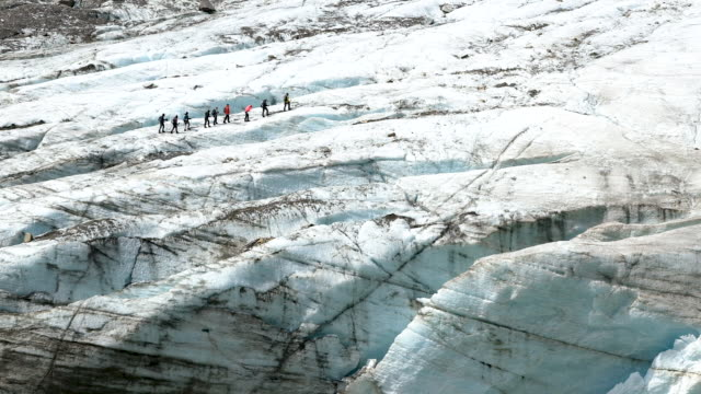 guide leads visitors on the surface of the retreating pasterze glacier on august 14, 2019 near heiligenblut am grossglockner, austria. the pasterze,... - human tongue stock videos & royalty-free footage