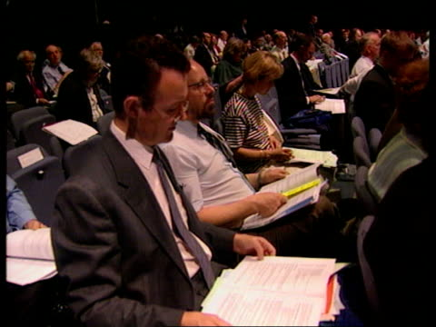guidelines for terminally ill; wales: cardiff: ext: i/c int: gvs doctors sitting at conference dr michael wilks intvwd - the law made in piecemeal... - michael barry stock videos & royalty-free footage