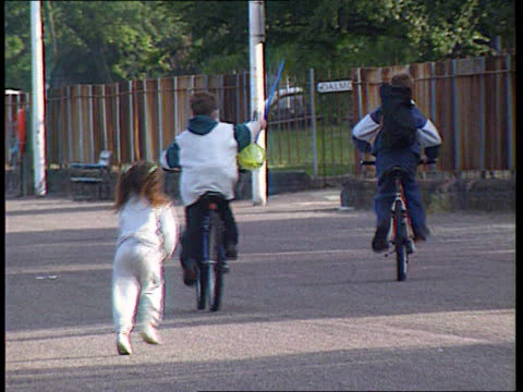 guidelines issued for the housing of sex offenders tx 27696 clywd bv young boys on bicycles with little girl running behind - mädchen stock-videos und b-roll-filmmaterial