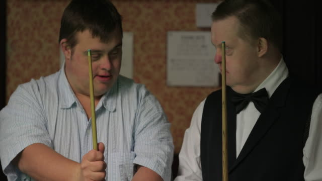 guiding a friend in snooker - effort stock videos & royalty-free footage