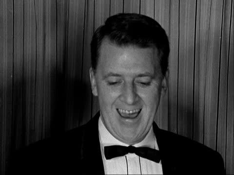guild awards; england: london: the dorchester hotel: int gv tv guild award masks [baftas] ditto gv crowd at presentation peter morley and cyril... - ネッド・シェリン点の映像素材/bロール