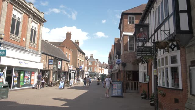 guildhall and shopping street on sunny day in summer, lichfield, staffordshire, england, united kingdom, europe - staffordshire england stock videos & royalty-free footage