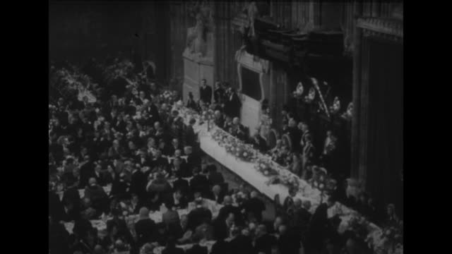 banquet to welcome couple home from travels / vs head table with prime minister winston churchill who stands to make a toast / cu princess elizabeth... - 1951 stock-videos und b-roll-filmmaterial